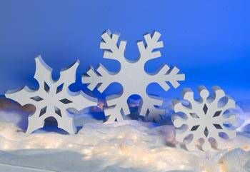 Our free-standing cardboard Standing Snowflakes are 8 inches deep and sparkle with iridescent glitter.