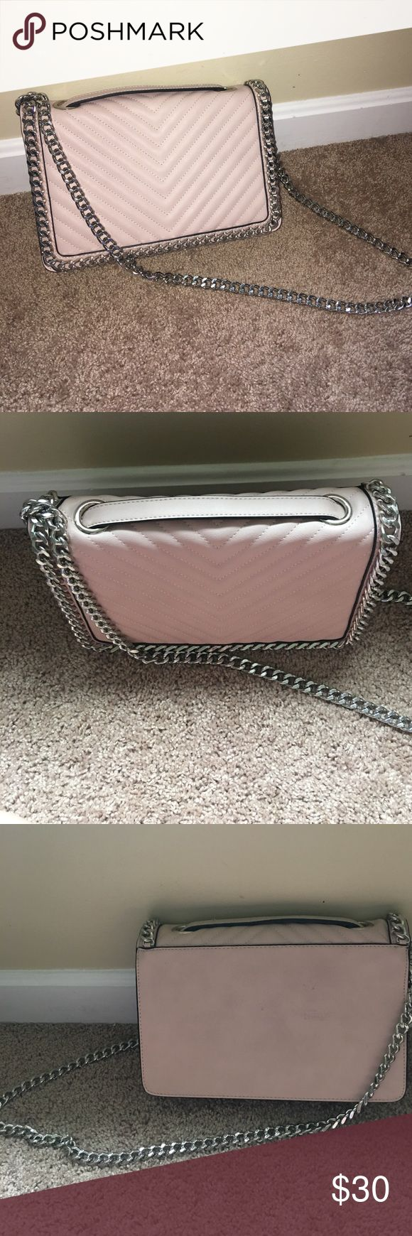 Blush Aldo purse with silver chain hardware Worn just once, blush purse from Aldo. Pretty quilted detailing in front/ reminds me of Rebecca minkoff style handbags. Really pretty and hot color for the season- I'm only getting rid of because I found a smaller one I like better! Aldo Bags Crossbody Bags