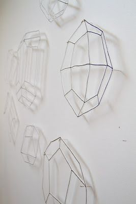 Paper cutouts of crystal formations by Bramble Workshop