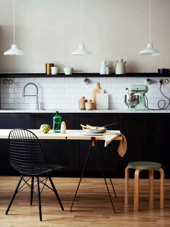 Black kitchen with white subway tile splash back.