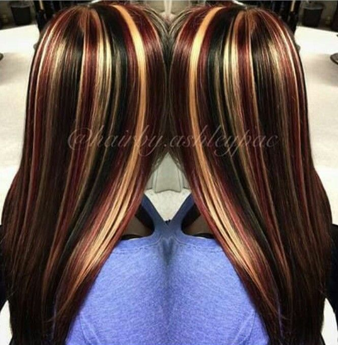 Black hair with chunky red and blonde highlights