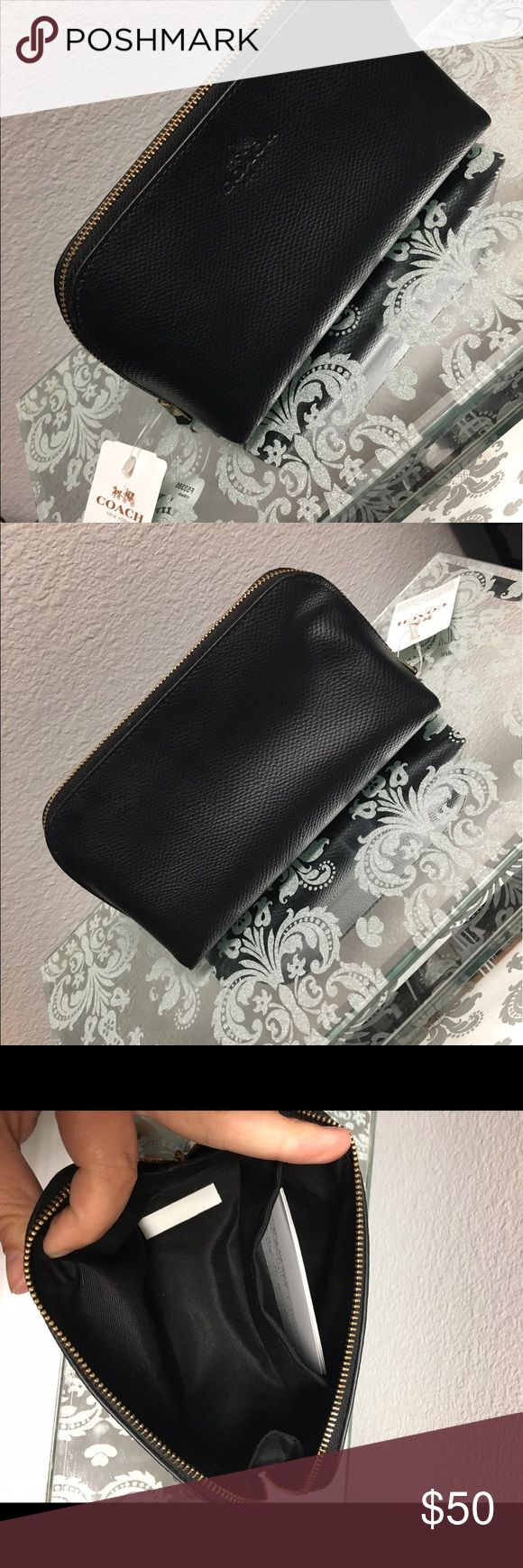 Small black Coach clutch Small black Coach leather clutch.  New wth tags ( NWT ) .  Received as a gift and never used.  No signs of wear. Perfect for small clutch, make up bag, or small bag to help organize a larger purse Coach Bags Cosmetic Bags & Cases