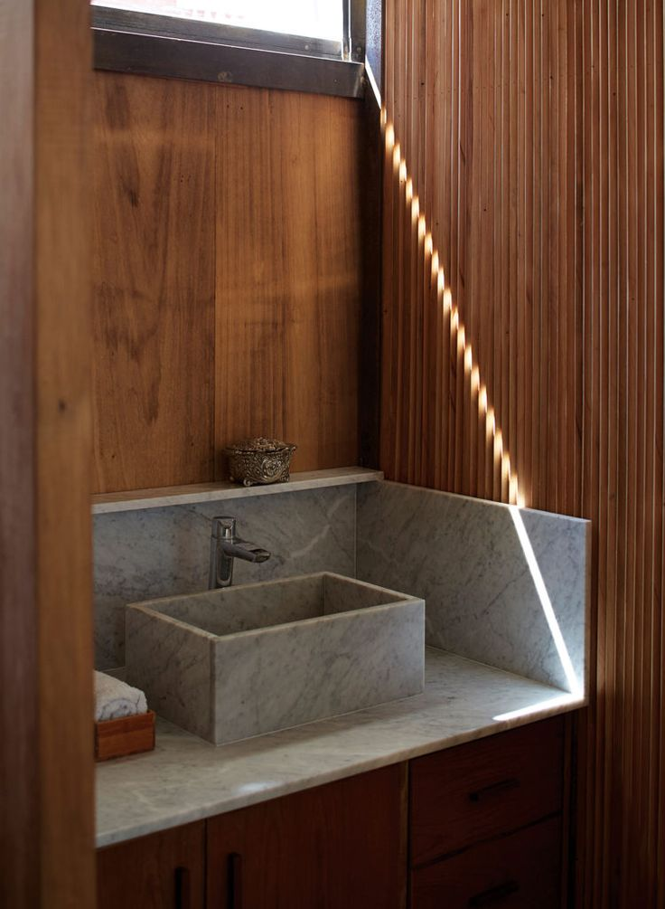 A bathroom with a Carrara marble sink.