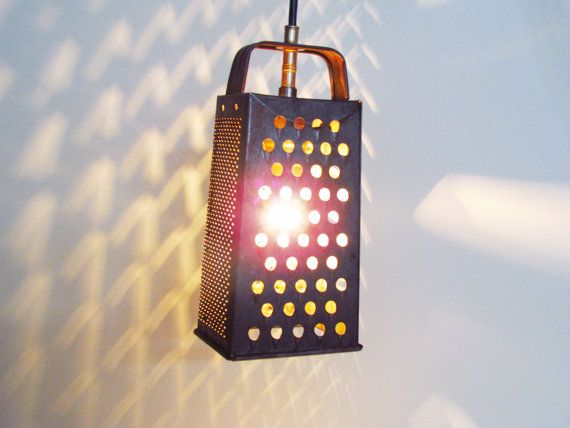 """Seller calls this Frankenfixture """"vintage handmade from the 1960s"""".  Which means the seller says they made this item over 50 years ago.  In the 1960s, crafty folks with a flair for unique home décor could do much better coming up with cool lighting than hanging their kitchenware from the ceiling.  That was then..."""