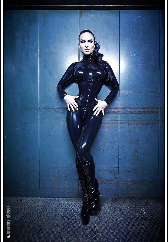 Sister sinister black latex catsuit