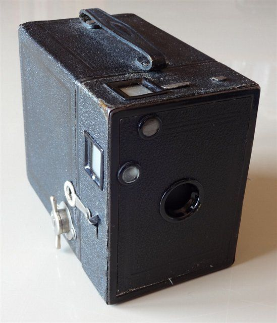 The history of cameras began in 1820, when Joseph Nicéphore Niépce invented a box camera prototype while working on a pinhole camera. Around 1870, in France, the very first box camera made its appearance on the market, even lacking a shutter mechanism: the photographer had to remove the lens cap to expose the photo.