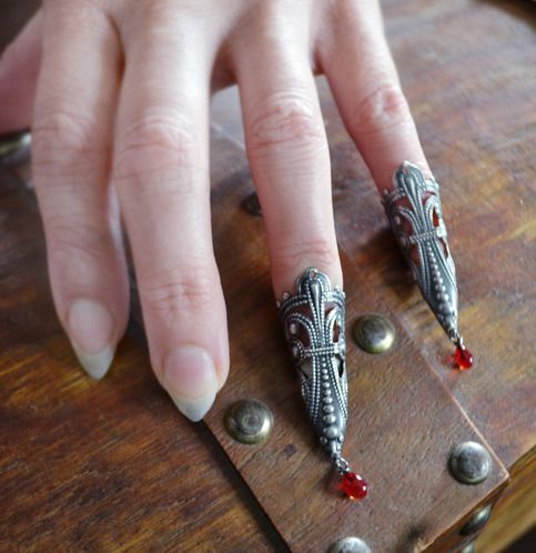 """Adjustable forged nail rings! This listing is for two rings as shown. Claw armor rings accented with my exclusive hand lampworked, individually made blood drop glass mini dangles!!! ( each """"blood drop"""" WILL vary as glass is handmade and no two turn out exactly the same but all are amazing!!!..."""