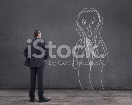 Businessman with Screaming Businessman Sketched on the Wall (royalty-free stock photo) © mgkaya