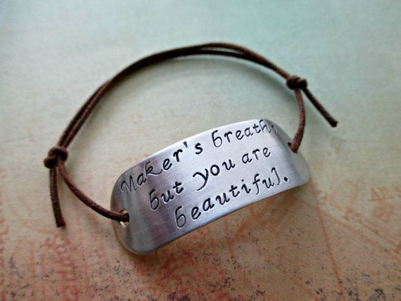 Okay, but seriously, this is the sweetest thing a nerdy lady could ever get. (Hand-stamped by TheWindFish, $12.00 on Etsy)