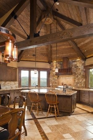 Rustic kitchen with a fabulous rounded wooden ceiling, just needs some hangers from the ceiling for pots!