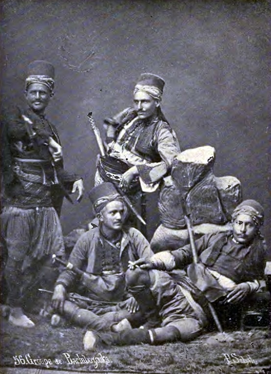 """Ottoman mountaineer irregulars, bashi bazouks, in the late 19th century. Date 1896, by Edwin Munsell Bliss, 1848-1919. Bashi-bazouk or bashibazouk (Turkish literally """"damaged head"""", meaning """"free headed"""", """"leaderless"""", """"disorderly"""") was an irregular soldier of the Ottoman army. Particularly noted for their lack of discipline."""