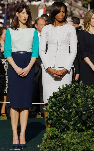 Michelle Obama's Re-Election Campaign Wardrobe: Meet Her New Favorite Designers: Wearing a Zac Posen skirt suit on March 14 with Samantha Cameron.  Photo: Getty.