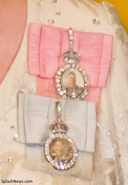 More than one Royal Family Order can be worn. In this case, they are worn layered with the most recent on top. For example, the Queen wears the Family Orders of her father King George VI which features a rose pink sash, and her grandfather King George V, a pale blue sash.