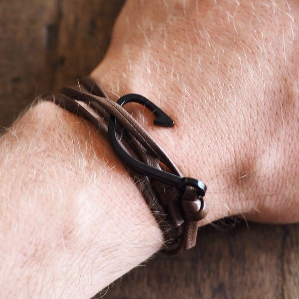 The Dansk men's leather bracelet available in two styles is hand fashioned with a silver zinc alloy fish hook to add that extra personality and flair. #leather #bracelet #accessories #menswear  Check out this: http://dappervigilante.com/