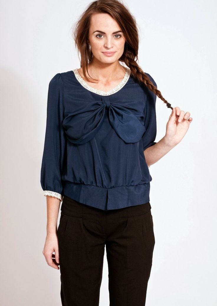 A PRETTY BOW BLOUSE THAT WOULD LOOK GREAT WITH SKINNY JEANS  This cute bow blouse has a rounded neck lace trim, three-quarter sleeves and a large bow to make it the perfect match for either a pair of skinny jeans or as it's nearly summer a pair of white jeans would look fabulous as well.  The peplum waist and button up back just add to the vintage blouse feel.