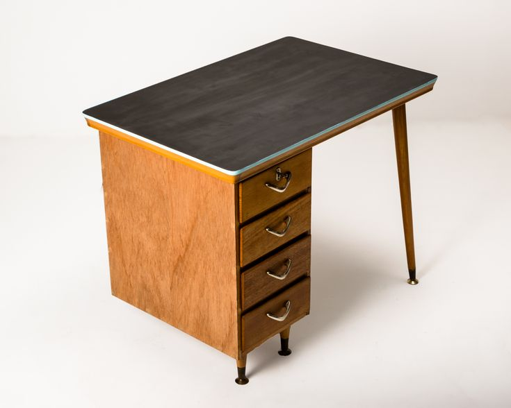 Four drawer desk in Queensland maple with boomerang handles
