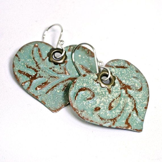LoVe these unique earrings...might have to order ......and they are recycled material!