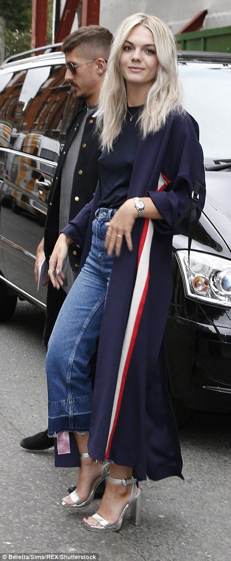 Trendy: Louisa Johnson looked fashionable in cut-off jeans, a long kimono and a navy shirt