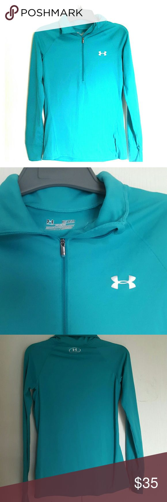 Teal under armour all seasons semi fitted top xs Like new. Worn only a handful o…