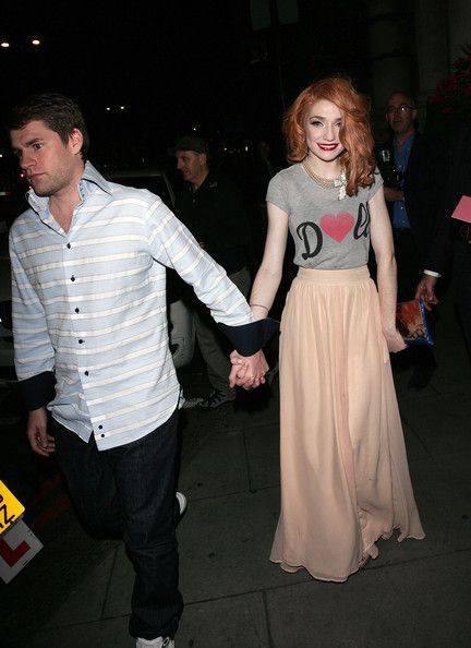 Nicola Roberts Photos - Nicola Roberts look quite happy in contrast to her boyfriend Charlie Fennell as they leave the Mandarin Oriental hotel in London. The Girls Aloud pop star, wearing a Doll t-shirt, launched her new makeup line at Harrods earlier in the day called Dainty Doll. - Nicola Roberts in London