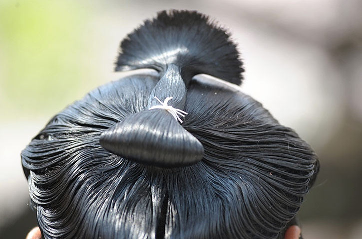 Tokyo, Japan: The 'top knot' of a sumo wrestler's hair is pictured as he attends an exhibition at Yasukuni shrine