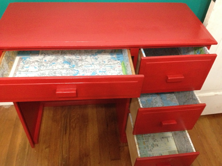 Boys desk painted bright red and drawers lined with maps
