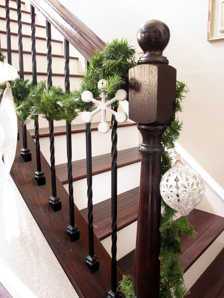 Wrought iron spindles, dark stain and white trim