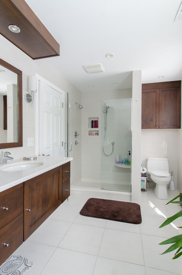 photos of remodeled bathrooms%0A Bathroom remodel dark brown cabinets  white countertop  custom built in  shower  matching