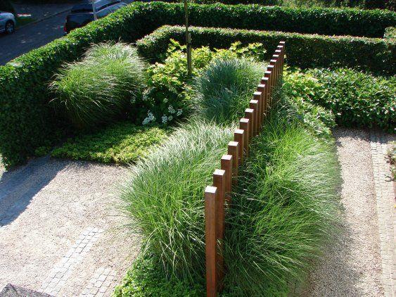 Timber bollards through grasses