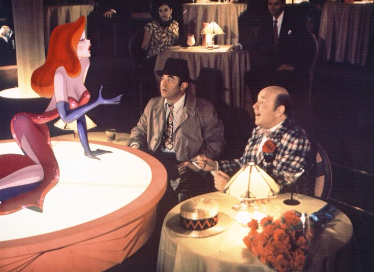"""Who Framed Roger Rabbit?"" movie still, 1988.  L to R: Jessica Rabbit, Bob Hoskins, Stubby Kaye."