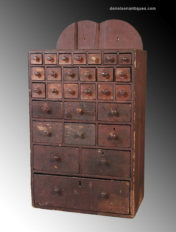 Rare 28 drawer apothecary chest in undisturbed crusty red-painted surface with fully dovetailed case and drawers, and retaining all original maple or cherry pulls. Just 30 inches tall.