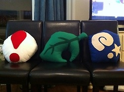 Cool Animal Crossing pillows! A pitfall seed, a piece of furniture (shaped like a leaf) and a fossil!!!