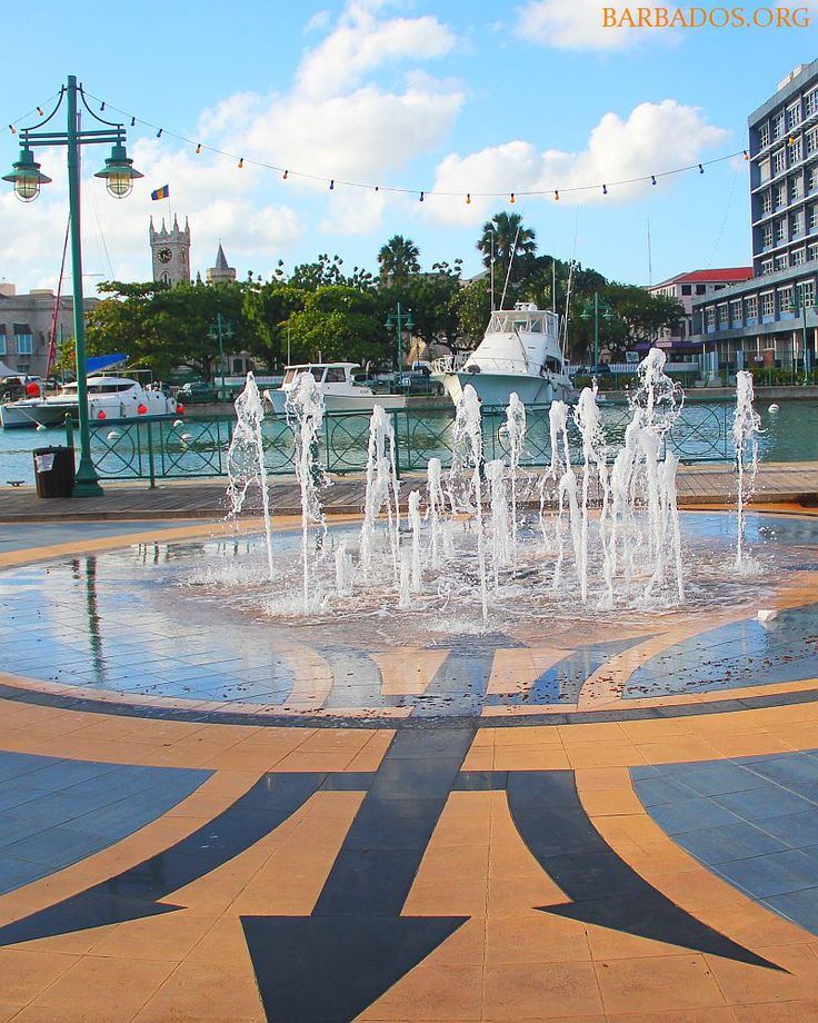 Enjoying views of the marina and historic parliament buildings in Independence Square, Bridgetown, Barbados.