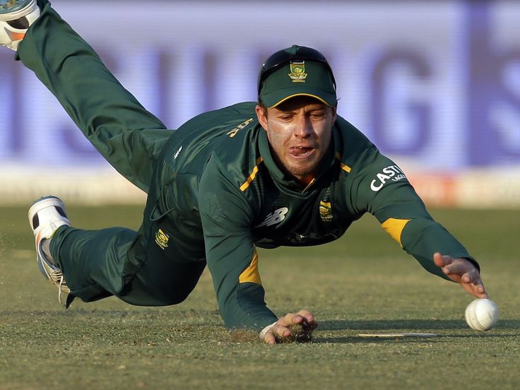 South Africa's captain AB de Villiers, fails to field off a shot from New Zealandís batsman Tom Latham, during their first one day international cricket match in Pretoria, South Africa.  Themba Hadebe, AP
