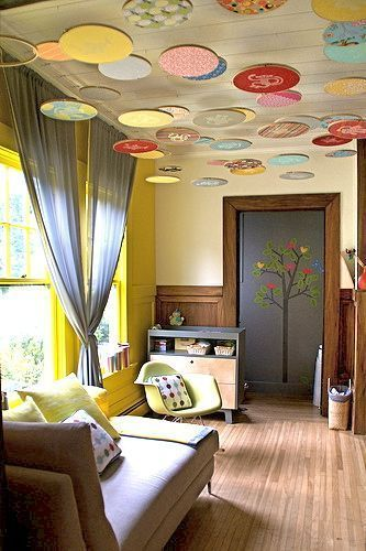 Colorful embroidery hoops are suspended from the ceiling of a nursery in a unique riff on a mobile. (Apartment Therapy, Via Design) Dazzle