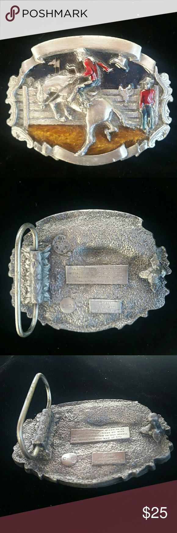 Rodeo Belt Buckle Enamel & Silver Rodeo Belt Buckle Enamel & Silver  This item is used and may have some knicks or scratches. Please review all photos and ask any questions prior to purchasing. Also, unless noted I am unsure of the type of materials used. Thank you! Accessories Belts