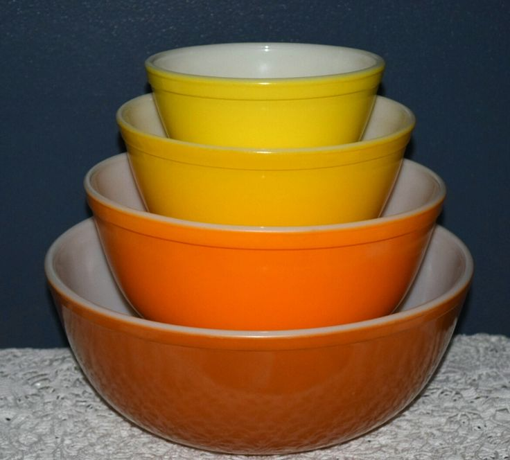 Description Vintage glassware mixing bowls manufactured by Pyrex in the 1960's. This a complete set of 4 nesting bowls in the Yellow Daisy/Citrus pattern. The colors are reminiscent of sunshine and pe