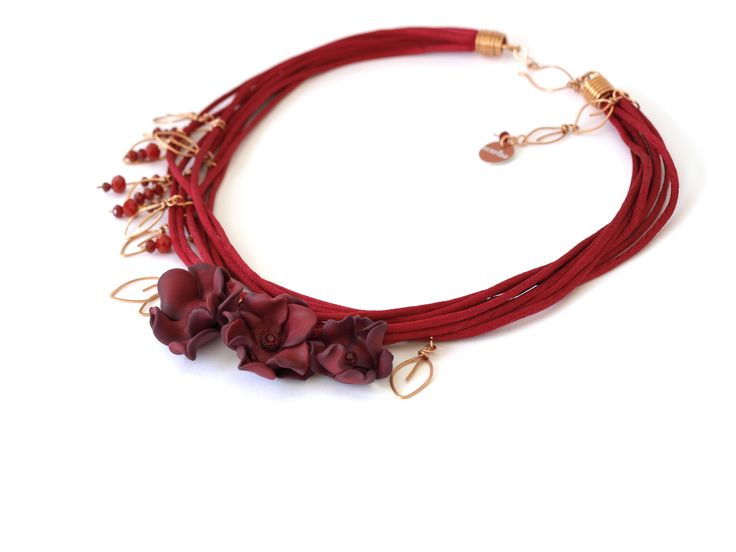 The perfect merger of flowers, leaves, and glittering beads... this Red Strings Necklace is the ideal settlement for the woman who wants to add glam & so ...
