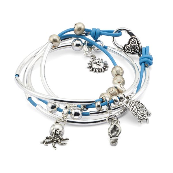 The Mini Addie Quartet leather wrap bracelet shown here includes 4 charms: sun, turtle, sandaland octopus charm. Designed to be worn as a wrap bracelet only, c