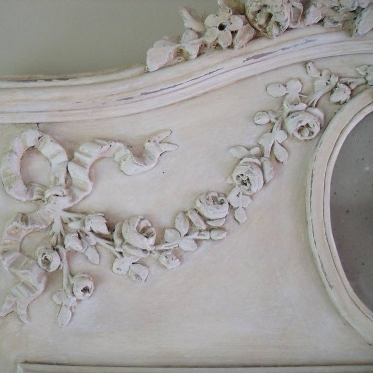 Add hand carved bows and flower sprays to furniture. You can find similar wood  appliques