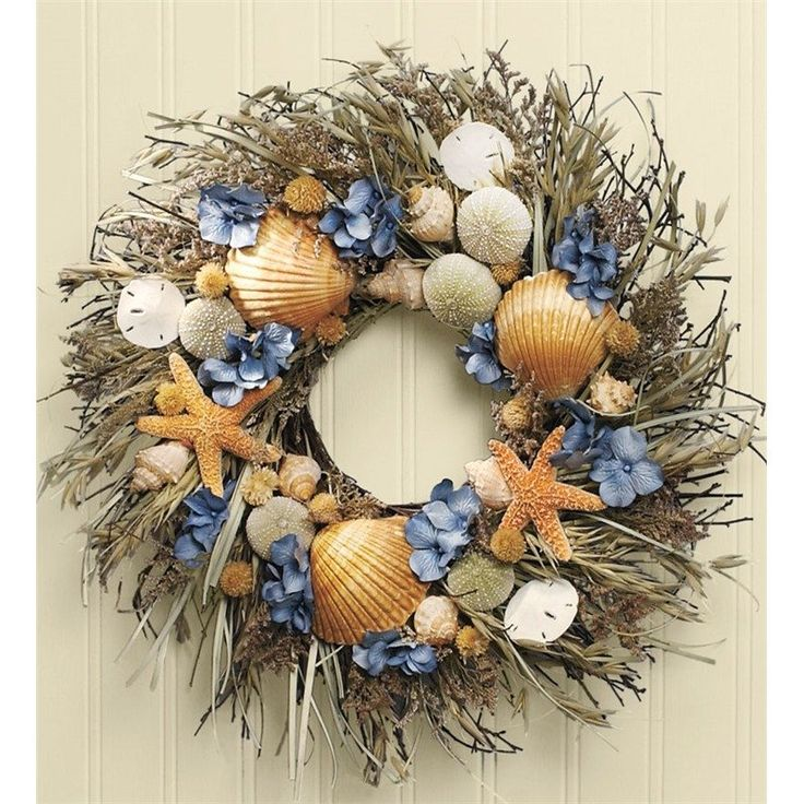 Woven with feathery caspia and stalky avena on a twig base, this bountiful seashell wreath is laden with a hand-selected collection of natural sea urchins, shel