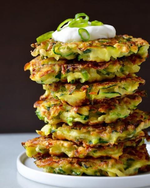 4 cups shredded zucchini 2/3 cup flour 2 large eggs, lightly beaten 1/3 cup sliced scallions (green and white parts) oil Sour cream, for serving (optional) Place the shredded zucchini in a colander set over a bowl and sprinkle the zucchini lightly with salt. Allow the zucchini to stand for…