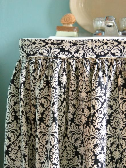 Pedestal sinks are ideal for tight spaces but often show exposed plumbing and offer little storage. An easy-to-sew sink skirt will solve both problems, providing style and function to a bathroom. Choose a trendy, patterned fabric, like damask, ikat or suzani, for maximum visual impact.