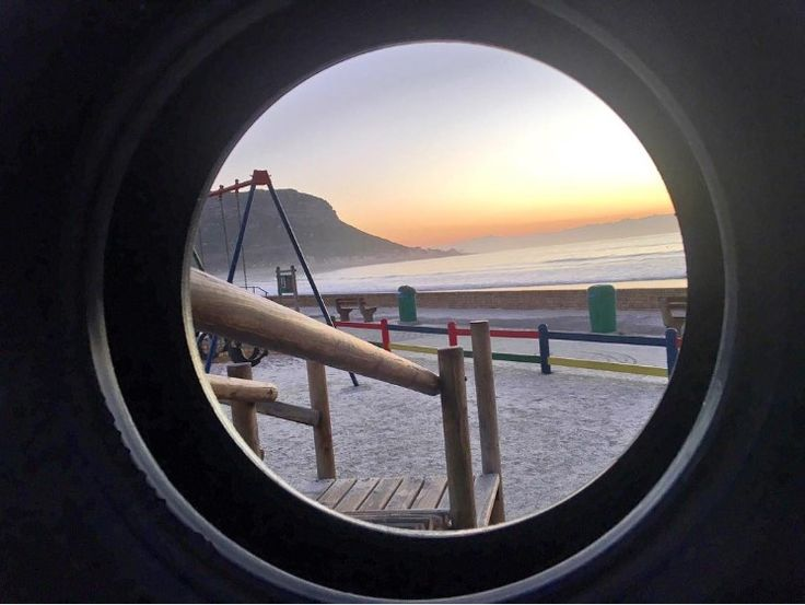"""Peekaboo I see you."" by Nicky Good  Location: Fish Hoek beach, Cape Town"