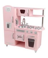 Young chefs serve up the best dishes from this interactive pink play kitchen. Featuring a cordless phone, easily cleaned and removable sink, and appliances with open and closing doors and turning and clicking knobs, it invites multiple children to cook together in an exciting and educational environment. Personalize up to 11 characters. Font is as shown and black.