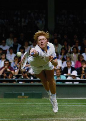 Boris Becker doing one of his signature dives at Wimbledon.