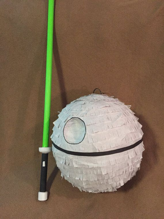 Hand made paper mâché Death Star pinata with all wood light saber hitting stick. The perfect addition to any Star Wars birthday party. The kids will love destroying this Death Star with their very own light saber!! Pinata measures a 40 inch circumference Light saber is 32 inches long, you can pick from red, green or blue Made when ordered!! Please allow 5 business days for production! We ship with USPS, you can choose from standard 2-9 day shipping or express 1-2 day shipping in your cart…