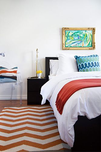 How To Brighten Up Your Space Right This Second #refinery29  http://www.refinery29.com/eclectic-home-decor#slide7  Carefully choose where you're going to put the pops of color or pattern. In one bedroom, a simple white bedspread is spruced up by adding an orange and white chevron rug, two differently patterned pillows, and an orange throw. If it's too much for you, start with one mixing two patterns, and gradually step out of your comfort zone. Shop similar: H&M Seat Cushion, $12.95, ...