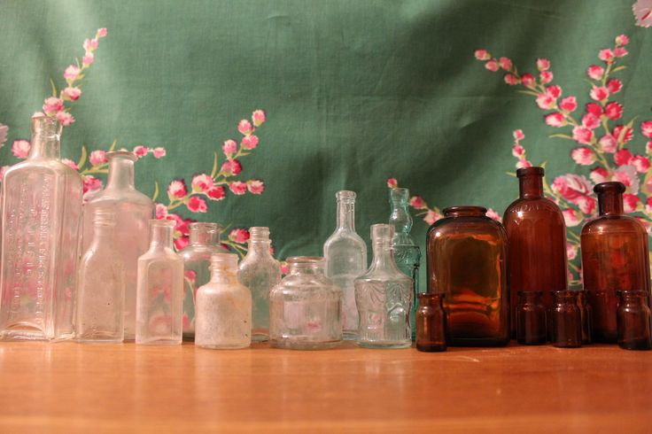 Vintage glass bottles. These beauties look wonderful lined up down a long table with single stems or holding table numbers.