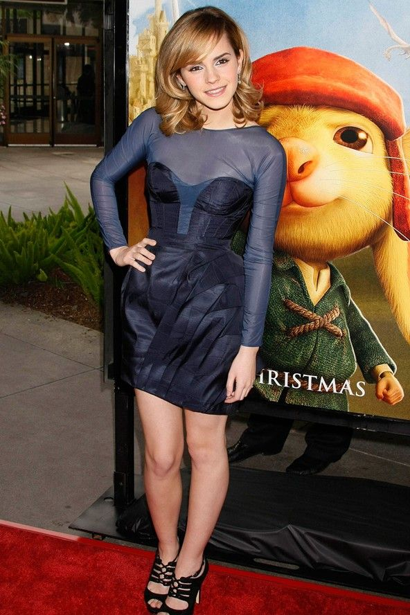 """""""2008 Emma flaunted fashion credentials worthy of a red carpet regular twice her age for the Tale Of Despereaux premiere in Hollywood. Her William Tempest midnight blue cocktail dress – with its busier detailing, folded skirt and plunging scoop back is elegant yet edgy."""""""
